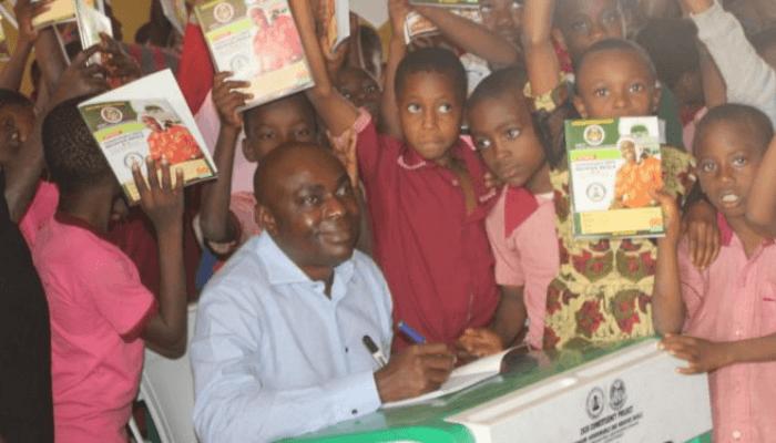 Uko Nkole with children in a class